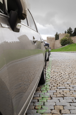 Beautiful view reflected in a car from the walls of the medieval city of Avila in Spain Stock Photo