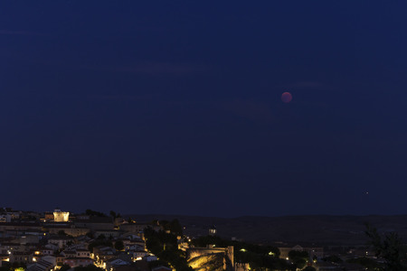 a panorama of a lunar eclipse or red moon next to Mars