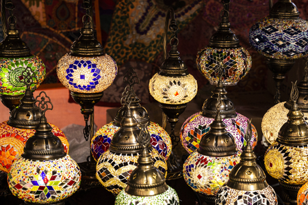 beautiful multicolored arabic lamps glowing at night in a market