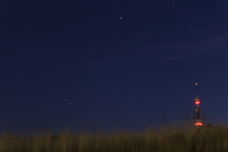 view of blue night sky starry with grass moving through air garter Stock Photo