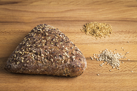 Integral bread in the form of a triangle with linseed, oats and sesame seeds Stock Photo