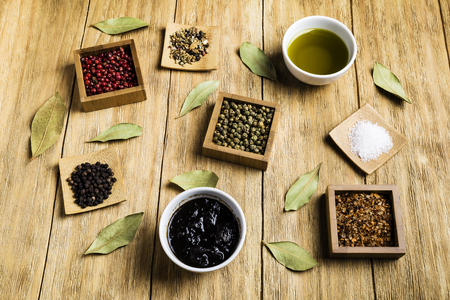 spices for a tasty meal on an old wooden table Imagens