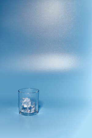 glass of clear and fresh water on a blue background 版權商用圖片