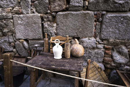 old kitchen utensils on a small wooden table on the outside Reklamní fotografie