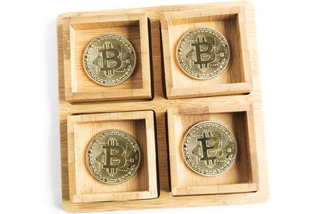 several bitcoin gold coins inside some wooden bowls Reklamní fotografie