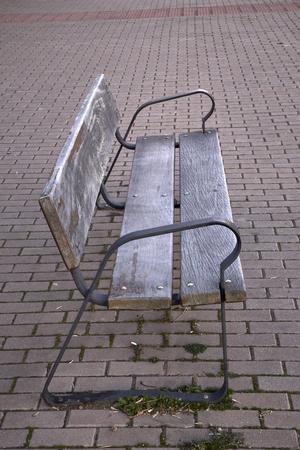 old empty wooden bench on the street of a city Reklamní fotografie