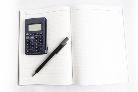 calculator and pen on an empty book with blank background