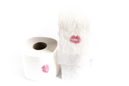 stained toilet paper roll with the red lips of a kiss of a woman in love