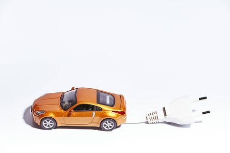 miniature of a vehicle with electric plug on a white background