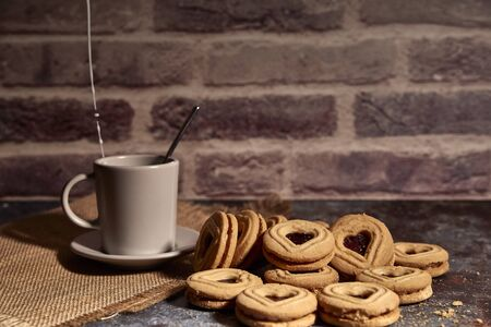 delicious bunch of sweet cookies next to a rich cup of hot milk Imagens