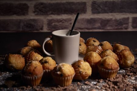 group of muffins with chocolate next to a cup of milk for breakfast Reklamní fotografie