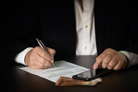 Close up businessman signing contract making a deal. Business concept