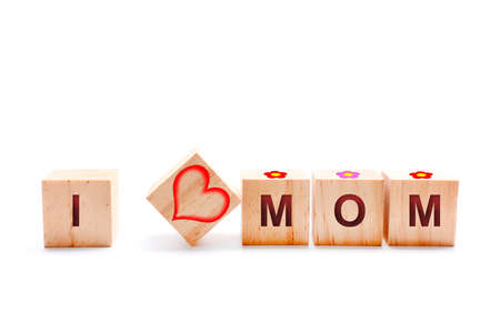 Wooden cubes with a heart, flowers and the words I and MOM.