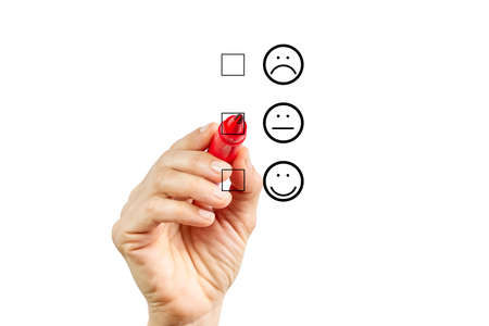 Woman hand putting check mark with red marker on half customer service evaluation form. Evaluation concept