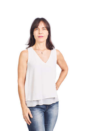 Beautiful woman in her fifties white blouse and jeans on a white background having a positive cheerful look