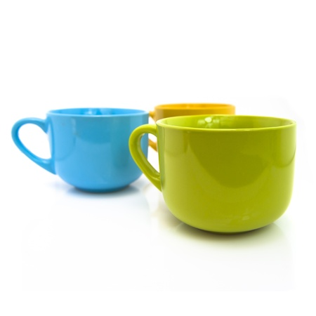 colorful cups isolated on white background.  photo