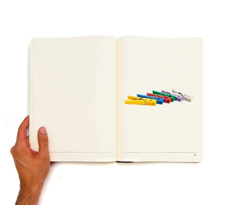 Group of Colorful Clothespin printed on white book photo