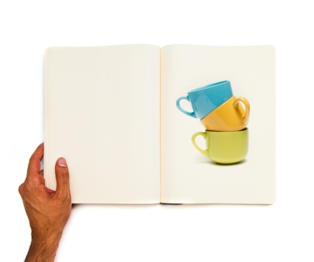 colorful cups printed on white book photo