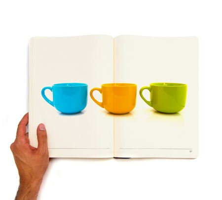 three colorful cups printed on white book. photo