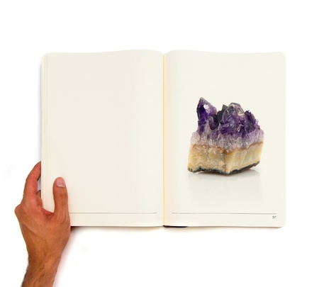single quartz printed on white book. photo