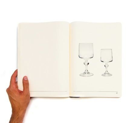 Two vintage glass printed on white book. photo