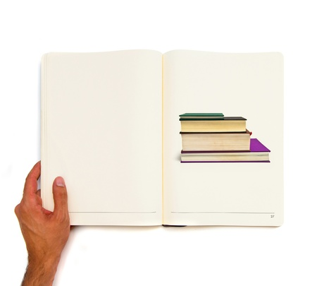 Hand holding white book with several books inside  photo