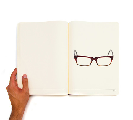 Glasses printed on white book  photo