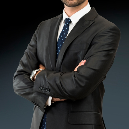 Business man with his arms crossed over isolated background  photo