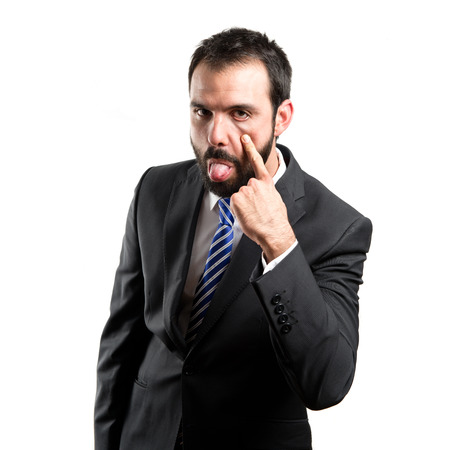mockery: Young businessman making a mockery over white background  Stock Photo