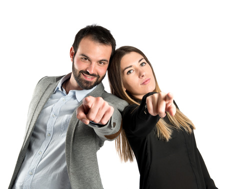 Couple pointing to the front over white background  photo