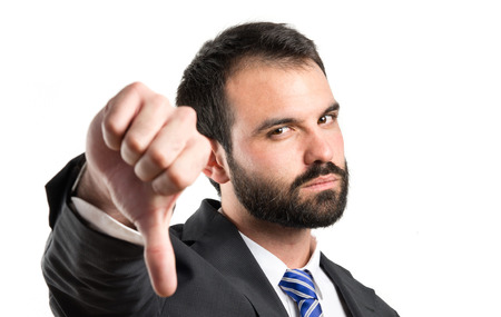 Businessman pointing to the side over white background  Standard-Bild