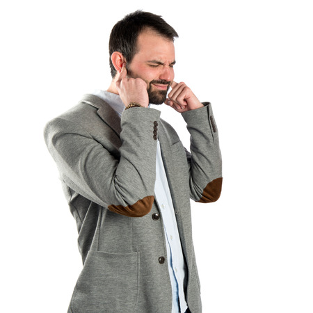 business man covering his ears over white background  photo