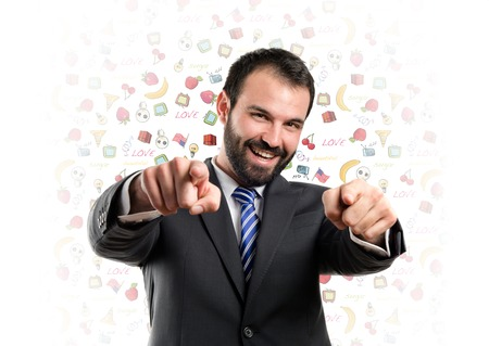 Businessman pointing to the front over white background  photo