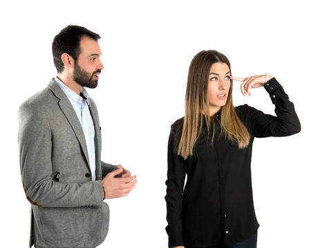 Businesswoman making a crazy gesture over white   photo