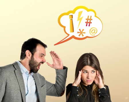 Businessman screaming at his girlfriend over yellow   photo