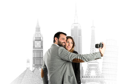Man photographing with his girlfriend in a trip  photo