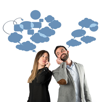 Couple talking to mobile over isolated background.  photo