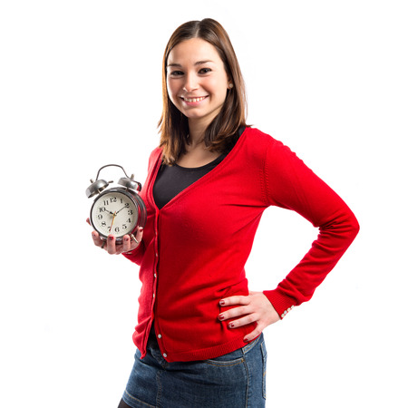 Happy young Girl holding an antique clock over white background  photo