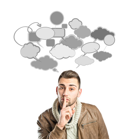 Young man making silence gesture over isolated white background  photo