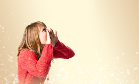 Young girl shouting over ocher  Stock Photo - 26193448