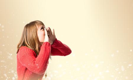 Young girl shouting over ocher Stock Photo - 26193448