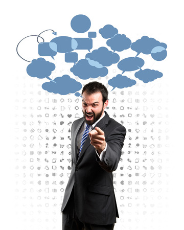 businessman angry and shouting over background with icons Stock Photo - 26243827