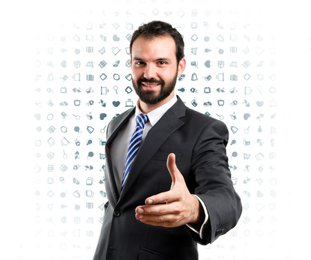 businessman making a deal over background with icons  photo