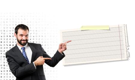 Businessman pointing to card over white background  photo