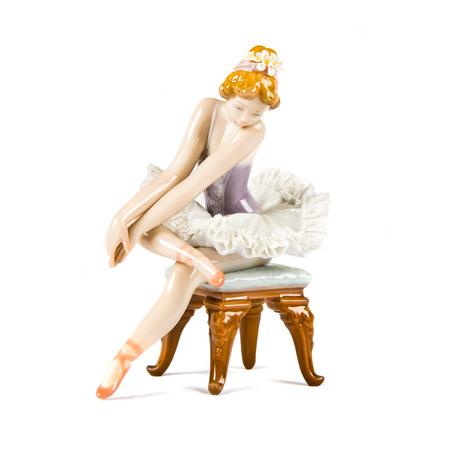 Porcelain doll  Dancing girl over white background