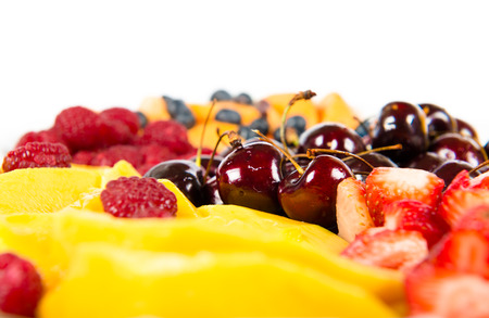 several colorful fruits over white background photo