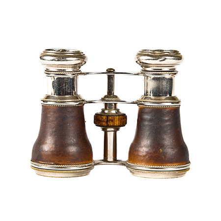 Vintage binocular over isolated white background  photo