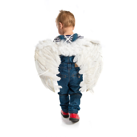 Cute kid with wings over white background  photo