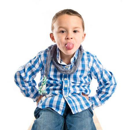 mockery: Boy making a mockery over isolated background