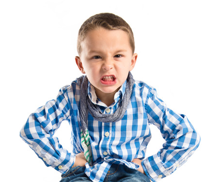 Boy furious over isolated white background  photo